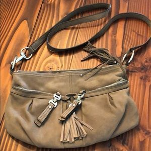 Crossbody purse with tassels